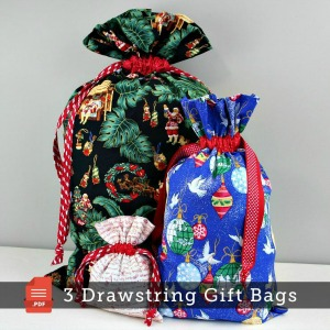 Three different sizes of drawstring fabric gift bags in various holiday prints.